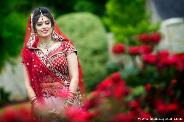 Indian wedding outdoor portraits bride red lengha in Temple, Texas Indian Wedding by Humza Yasin Photography