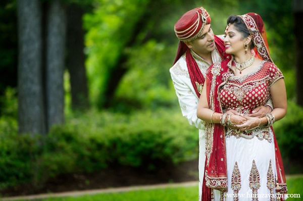 Indian wedding portraits bride groom outdoor red white lengha in Temple, Texas Indian Wedding by Humza Yasin Photography