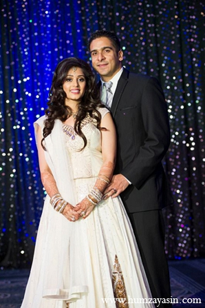 Indian wedding reception outfits bride groom white lengha in Temple, Texas Indian Wedding by Humza Yasin Photography