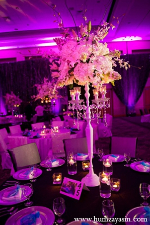 Indian wedding reception white floral arrangements purple lighting in Temple, Texas Indian Wedding by Humza Yasin Photography