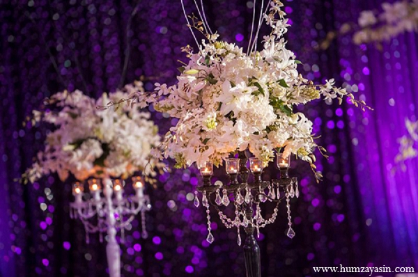 Indian wedding reception white floral arrangments purple decor in Temple, Texas Indian Wedding by Humza Yasin Photography