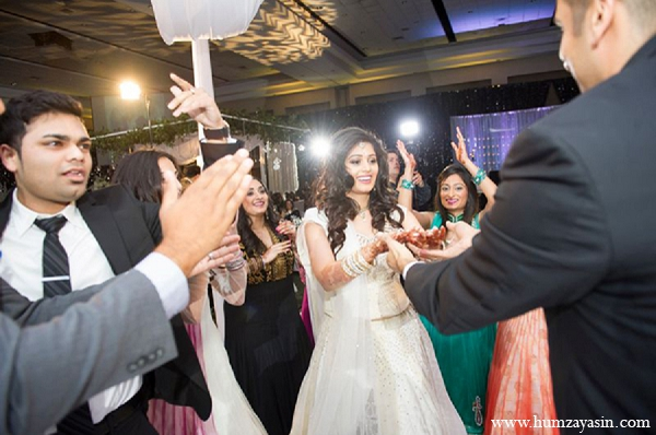Indian wedding reception white lengha bride in Temple, Texas Indian Wedding by Humza Yasin Photography