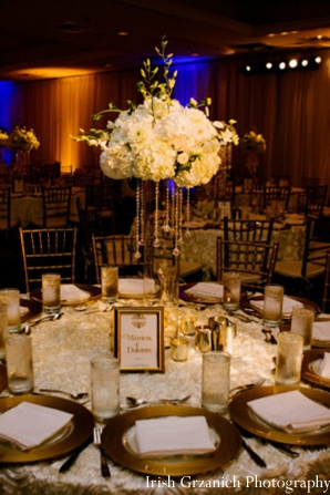 Indian wedding reception table setting floral arrangement