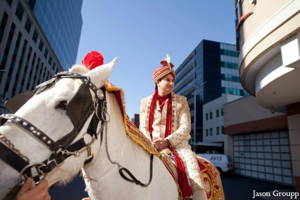 Indian wedding baraat groom white horse in Exquisite Indian Wedding by Jason Groupp Photography, Jersey City, New Jersey