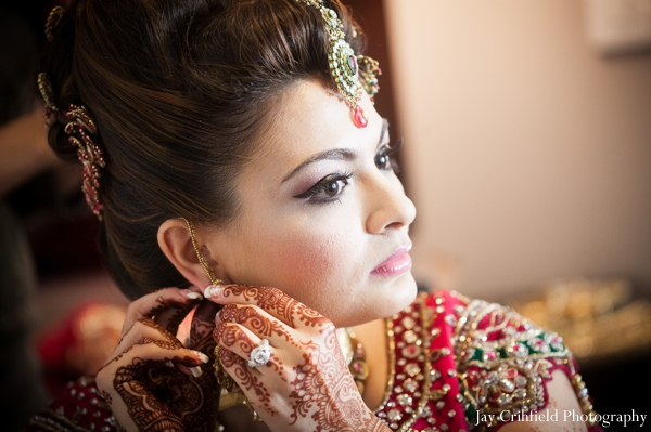 Indian wedding bride prep for ceremony in Chicago, Illinois Indian Wedding by Jay Crihfield Photography