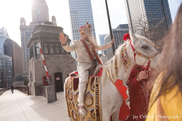 Indian wedding baraat white horse traditional celebration in Chicago, Illinois Indian Wedding by Jay Crihfield Photography
