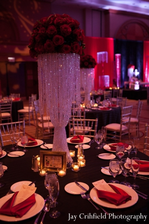Indian wedding reception venue table setting in Chicago, Illinois Indian Wedding by Jay Crihfield Photography