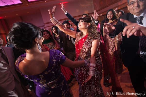 Indian wedding reception dancing celebration in Chicago, Illinois Indian Wedding by Jay Crihfield Photography