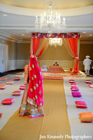 Indian-wedding-ceremony-mandap-indoors-chandelier-fabric-floral