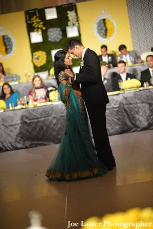 Indian-wedding-bride-groom-dancing-reception