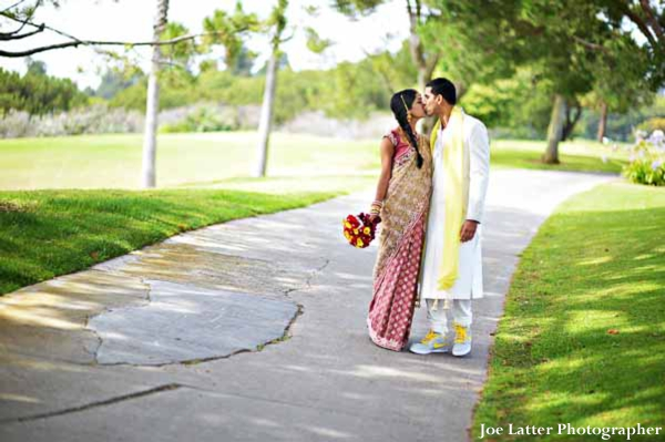 Indian-wedding-bride-groom-kissing-portrait