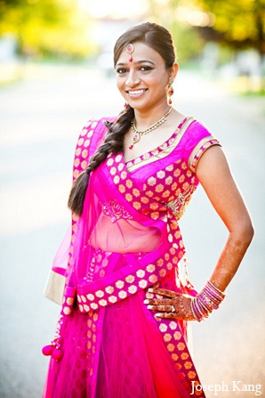 Indian wedding bride garba night fashion pink lengha in Chicago, Illinois Indian Wedding by Joseph Kang