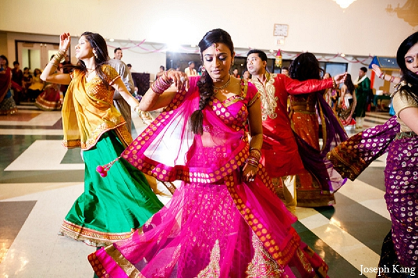 Indian wedding bride garba night pink lengha in Chicago, Illinois Indian Wedding by Joseph Kang