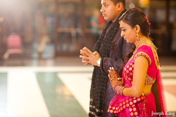 Indian wedding bride groom garba night outfit pink in Chicago, Illinois Indian Wedding by Joseph Kang
