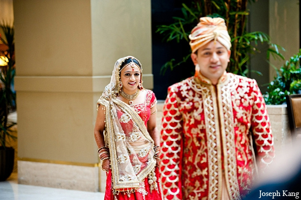 Indian wedding bride groom red lengha fashion first look in Chicago, Illinois Indian Wedding by Joseph Kang