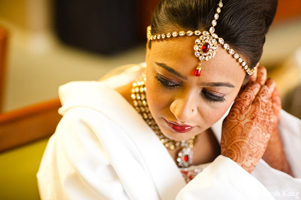 Indian wedding bride jewelry makeup getting ready in Chicago, Illinois Indian Wedding by Joseph Kang