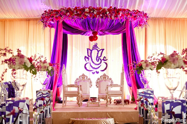 Indian wedding ceremony decor mandap purple pink in Chicago, Illinois Indian Wedding by Joseph Kang