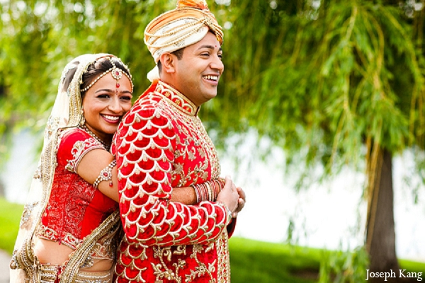 Indian wedding portraits bride groom outdoor red sherwani lengha in Chicago, Illinois Indian Wedding by Joseph Kang