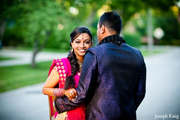 Indian wedding portraits garba bride groom outdoor pink lengha in Chicago, Illinois Indian Wedding by Joseph Kang