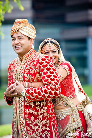 Indian wedding portraits groom bride red fashion lengha sherwani in Chicago, Illinois Indian Wedding by Joseph Kang