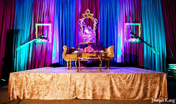 indian wedding reception blue gold purple decor
