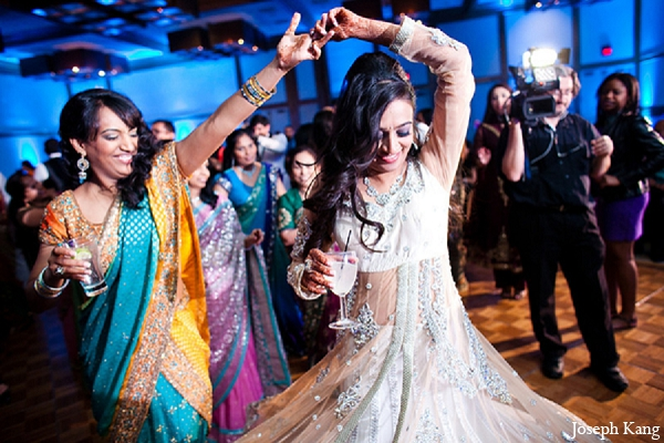 Indian wedding reception bride white lengha in Chicago, Illinois Indian Wedding by Joseph Kang