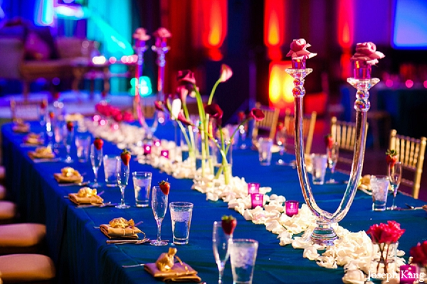 Indian wedding reception decor blue table settings in Chicago, Illinois Indian Wedding by Joseph Kang