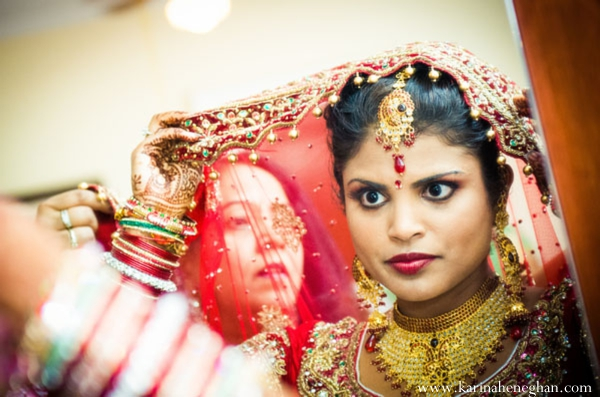 Indian-wedding-bride-getting-dressed-for-ceremony