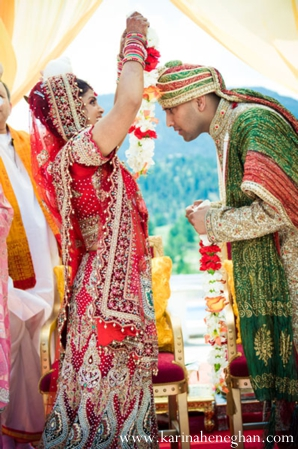 Indian-wedding-bride-places-jai-mala-on-groom