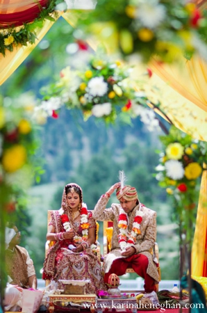 Indian-wedding-couple-at-mandap-floral