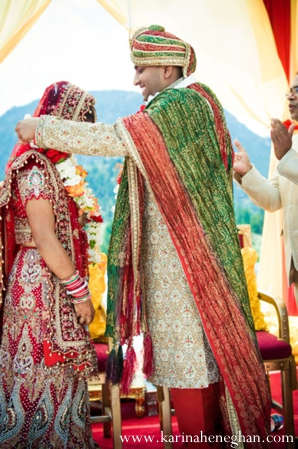Indian-wedding-groom-places-jai-mala-on-bride