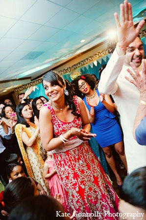 Indian wedding reception bride pink lengha in Neptune, New Jersey Indian Wedding by Kate Connolly Photography