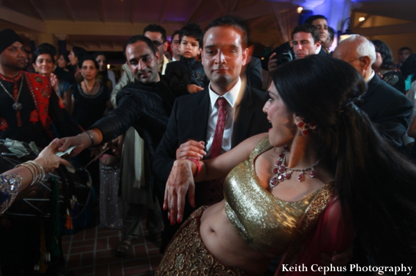 Indian-wedding-bride-dancing-at-reception