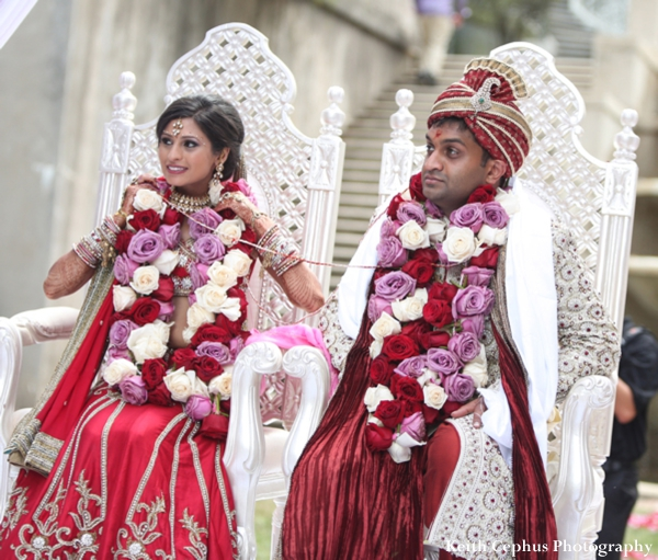 An indian wedding bride and groom performing traditional rituals and customs at their ceremony.