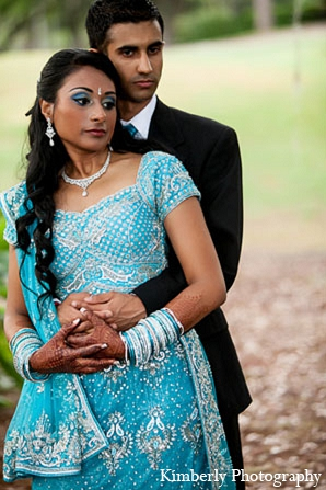 Indian wedding reception blue lengha bride groom in Palm Harbor, Florida Indian Wedding by Kimberly Photography