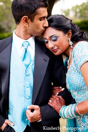Indian wedding reception bride groom blue lengha in Palm Harbor, Florida Indian Wedding by Kimberly Photography