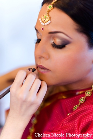 Indian wedding bride makeup jewelry red gold eye