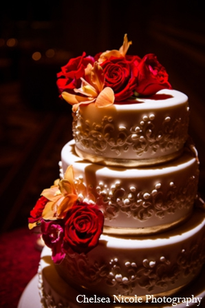 Indian wedding reception cake red gold