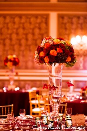 Indian wedding reception floral centerpiece red gold