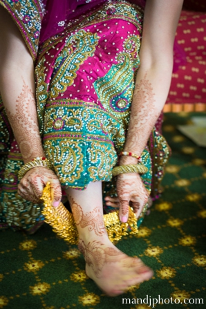 Indian wedding bride getting ready henna