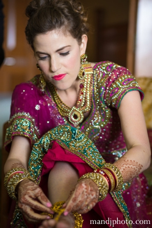 Indian wedding bride getting ready traditional dress