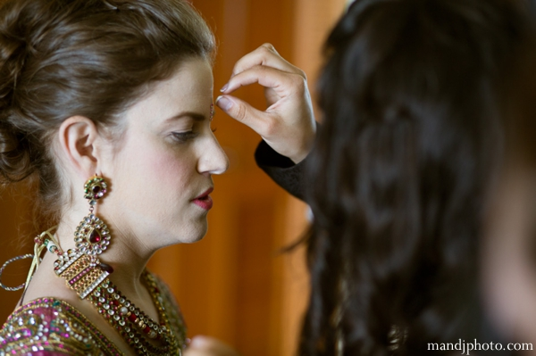Indian wedding bride getting ready traditional jewelry