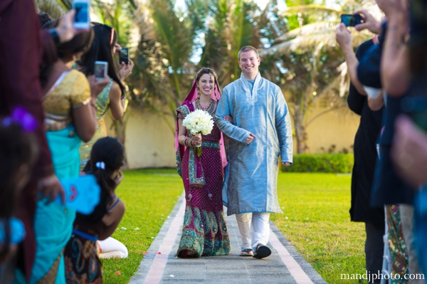Indian wedding bride walks down aisle