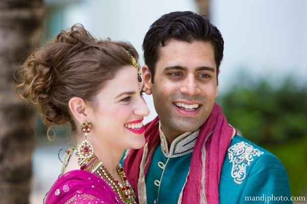 Indian wedding portrait of the bride and groom dressed in their traditional ceremony dress.