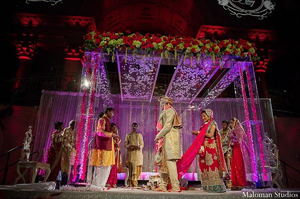 Indian wedding bride groom mandap in New York, New York Indian Wedding by Maloman Studios