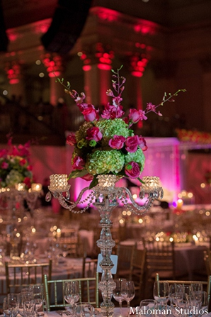 Indian wedding reception decor centerpiece lighting in New York, New York Indian Wedding by Maloman Studios