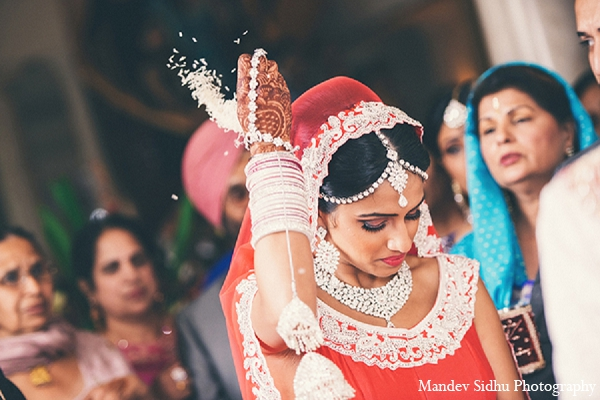An Punjabi bride and groom wed in a traditional Sikh ceremony. Their wedding festivities also include a maiya and doli.