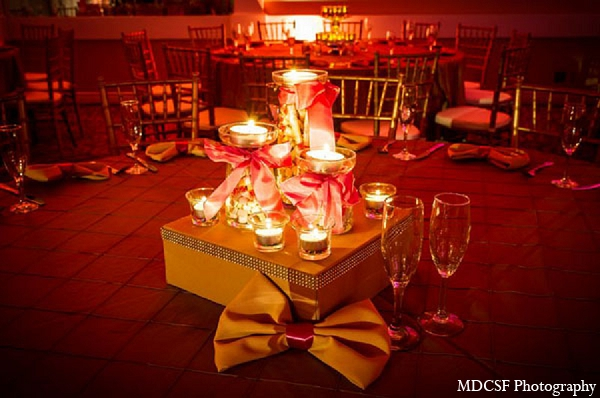 Indian wedding reception decor gold table setting candles in San Jose, California Indian Wedding by MDC SF Photography