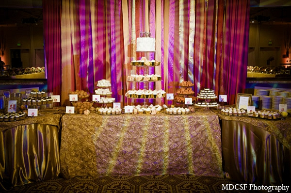 Indian wedding reception dessert table treats cake in San Jose, California Indian Wedding by MDC SF Photography