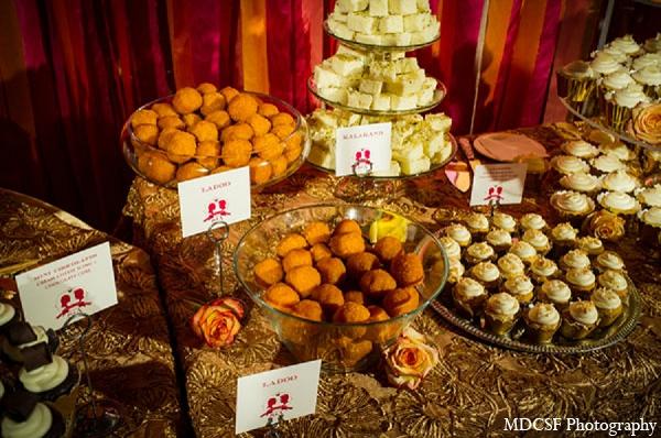 Indian wedding reception ladoos treats in San Jose, California Indian Wedding by MDC SF Photography